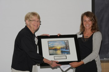 Midge Ogletree, left, accepting the award for the Town of Columbia from federation's coastal advocate, Ladd Bayliss.