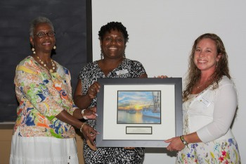 Lenora Jarvis-Mackey, left, and Angie Willis, center, accept the award from federation's education coordinator, Sara Hallas.