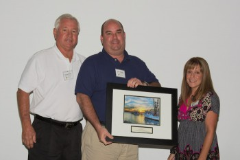 Jayson, left, and Wayne Barber accept the award from federation's coastal scientist Dr. Lexia Weaver.