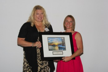 Dana Edgren accepting the award from federation's education coordinator Sarah Phillips, right.