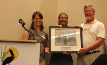 Bill Edwards, accepting the award from federation's coastal scientist Erin Fleckenstein, left, and federation's vice president Lauren Hermley.