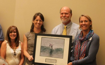 Craig Hardy, accepting the award from federation's coastal scientits, Dr. Lexia Weaver, left, and Erin Fleckenstein, and the federation's vice president Lauren Hermley, far right.