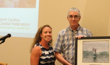 Ernest Boyce accepting the award from federation's education coordinator, Sara Hallas, left, and federation's vice president Lauren Hermley.