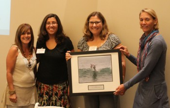 Mindy Furrer, second from right, and Meghan Dinneen, second from left, accepting the award from federation's coastal scientist Dr. Lexia Weaver (far left) and federation's vice president Lauren Hermley.