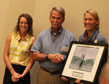 Troy Outland, accepting the award from federation's coastal advocate Ladd Bayliss, left and federation's vice president Lauren Hermley.