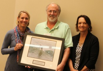 Jerry Parnell,center, accepting the award for the UNCW William Madison Randal Library from federation's coastal scientist, Tracy Skrabal, right, and federation's vice president Lauren Hermley.