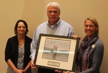 Tony Wilson accepting the award from federation's coastal scientist Tracy Skrabal, left, and federation's vice president Lauren Hermley.