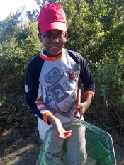 This student just caught a shrimp in the estuary.