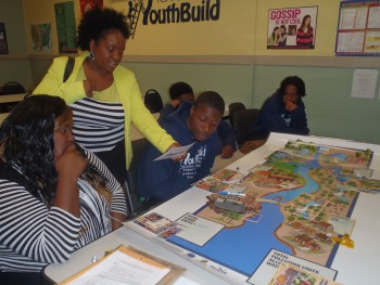 Angie Wills, YouthBuild program director, participates in a watershed activity with her students, during one of the classroom training sessions led by the federation