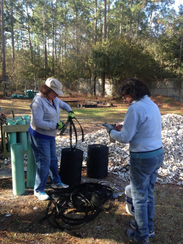 Volunteers bag recycled oyster shells at the headquarters office.