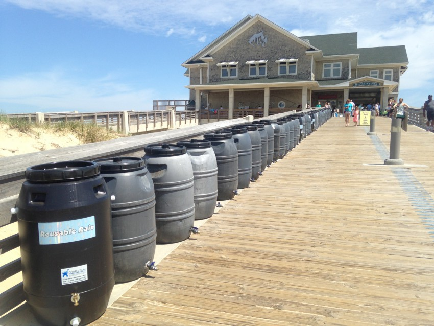 Rain Barrels lined up at Jennette's Pier for participants at Earth Fair to win.