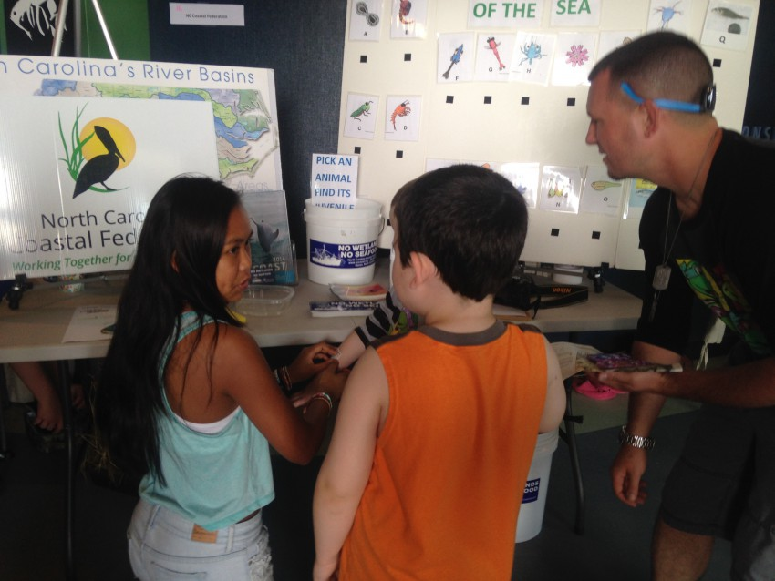 Visitors learn about the importance of estuaries at the federation's Earth Fair Booth