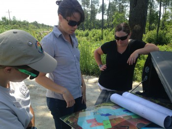 Federation scientist, Erin Fleckenstein explaining the project to consultants Melissa Midgett and Amanda Miller, during a recent site visit.