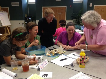 The teachers participated in a variety of hands-on learning both indoors and out as shown here with Terri Kirby Hathaway.
