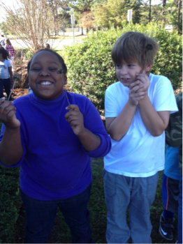 Third grade students in the southeast coast work together in their school rain gardens