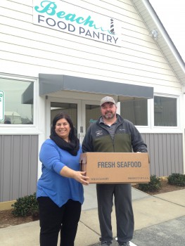 Theresa Armendarez, Beach Food Pantry, accepting fresh tilefish fillets donated from local commercial fishermen, including Dewey Hemilright.