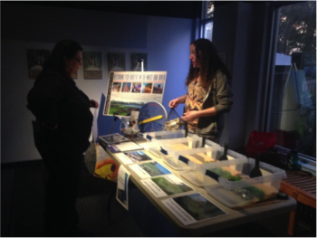 Coastal Fellow, Kristen Daly, describes the lesson to an educator at the local SciREN event in Pine Knoll Shores.