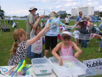 Children blow bubbles at the Titan-Free Jamboree Sunday in Wilmington.