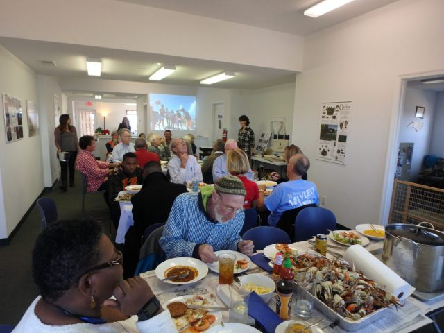 Volunteers enjoyed the spread at the Wanchese office party.