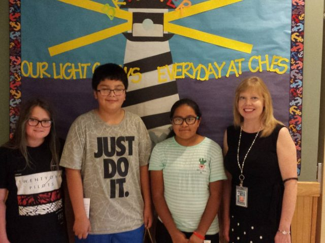 Cape Hatteras Elementary (left to right): Kinzlie Philips (second-place), Anthony Zenteno Luna (first-place), Sherlyn Mendieta-Lozano (third-place) and Principal Sherry Couch
