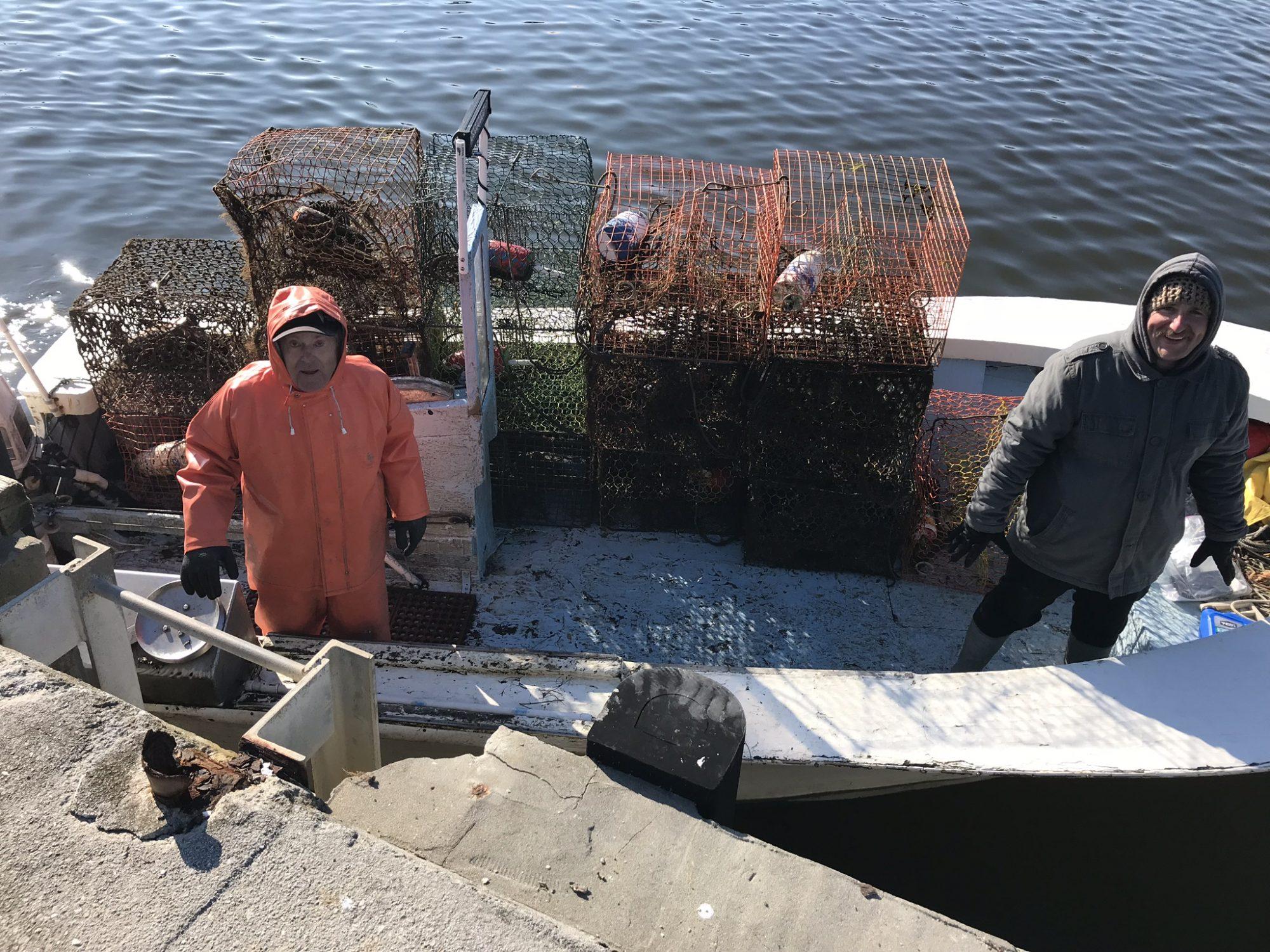 Fishermen collecting crab pots