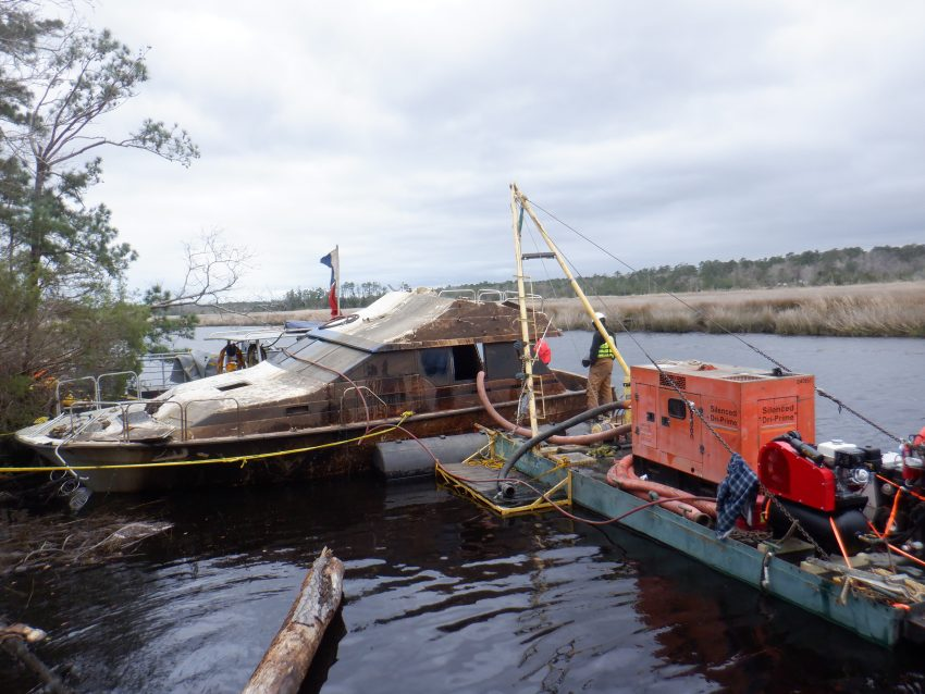 The federations removes a derelict vessel from Lockwood Folly River