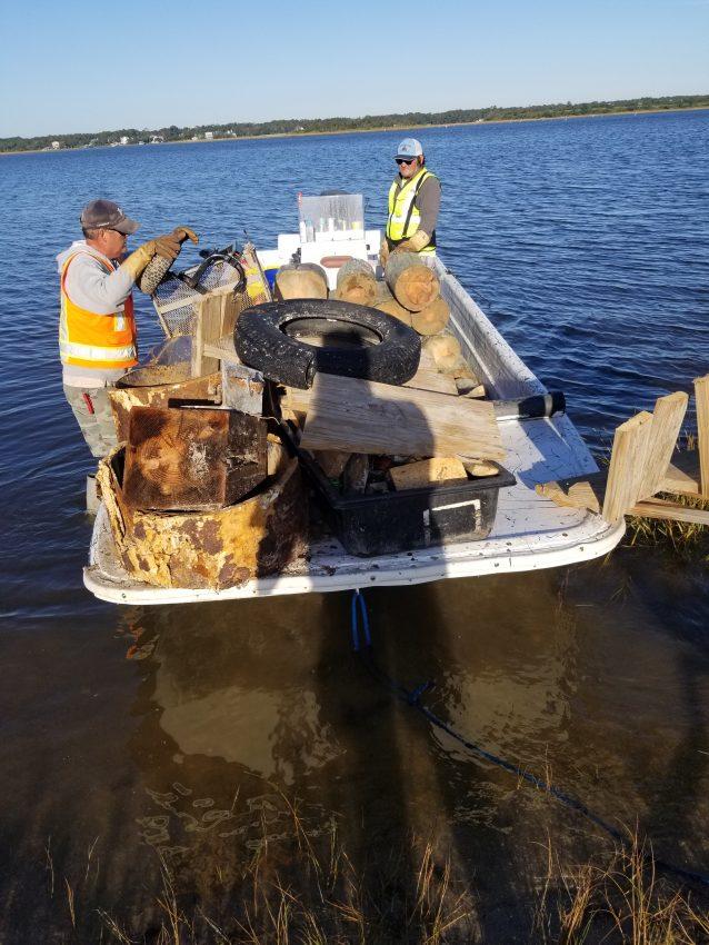 Marine Debris Removal crew members Mike Willis and Joey Huey with debris from Masonboro.
